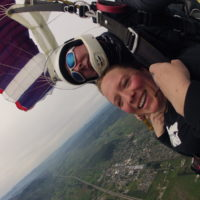 woman smiles tandem skydiving in Western Oregon