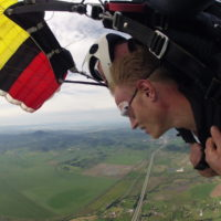 man enjoys the views of Oregon under skydiving canopy