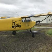yellow Cessna plane at Eugene Skydivers