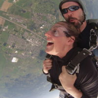 woman experiences the exhilaration of skydiving freefall