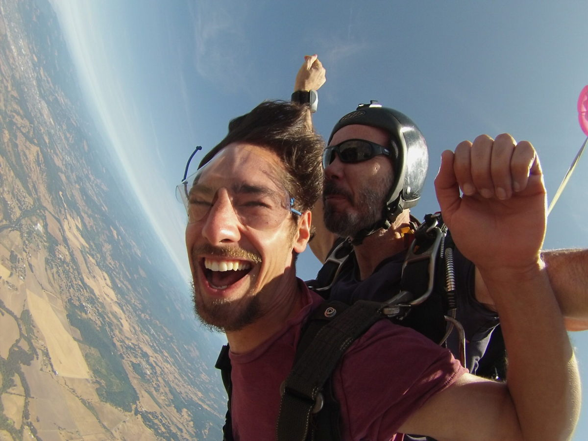 1251cb04e93ed man smiles ear to ear while in tandem skydiving freefall