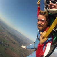 first time skydiver soars over the Willamette Valley in Oregon under canopy